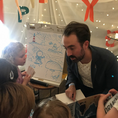 Benji Davies talking to children at the Old Vic Bicentenary celebration event in 2018