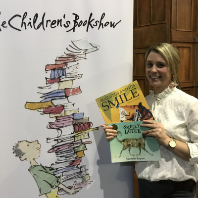 Catherine with her books and The Children's Bookshow sign