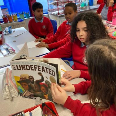 Children reading *The Undefeated* at Bangabandhu Primary