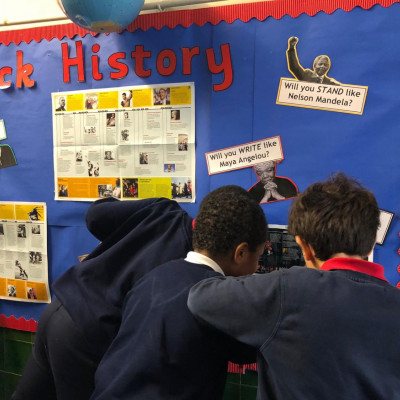 Children from Ravenstone Primary with their black history display