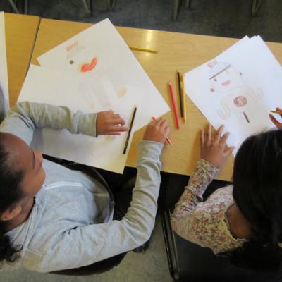 Children working in one of Alexis Deacon's workshops