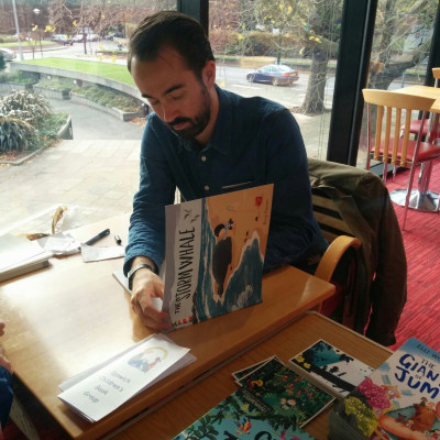 Benji Davies signs books after his performance in Ipswich is 2015.