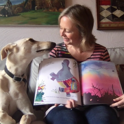 Jo Empson reading her book *Jungle Jamboree* with her dog Wilfred