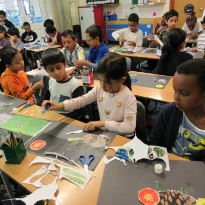 Children from Blue Gates Field Juniors making collages during Neal Layton's workshop