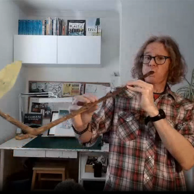Neal playing his stick saxophone during his Digital Festival event