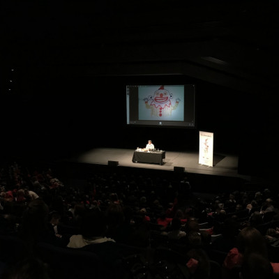 Satoshi drawing clowns for the audience at Warwick Arts Centre
